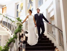 Bride & Groom on the Red Cow Moran Hotel Staircase