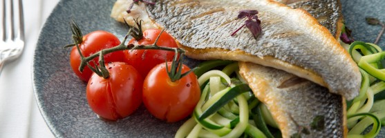 Tom's Table grilled fillets of seabass on courgette spaghetti with vipe ripened tomatoes